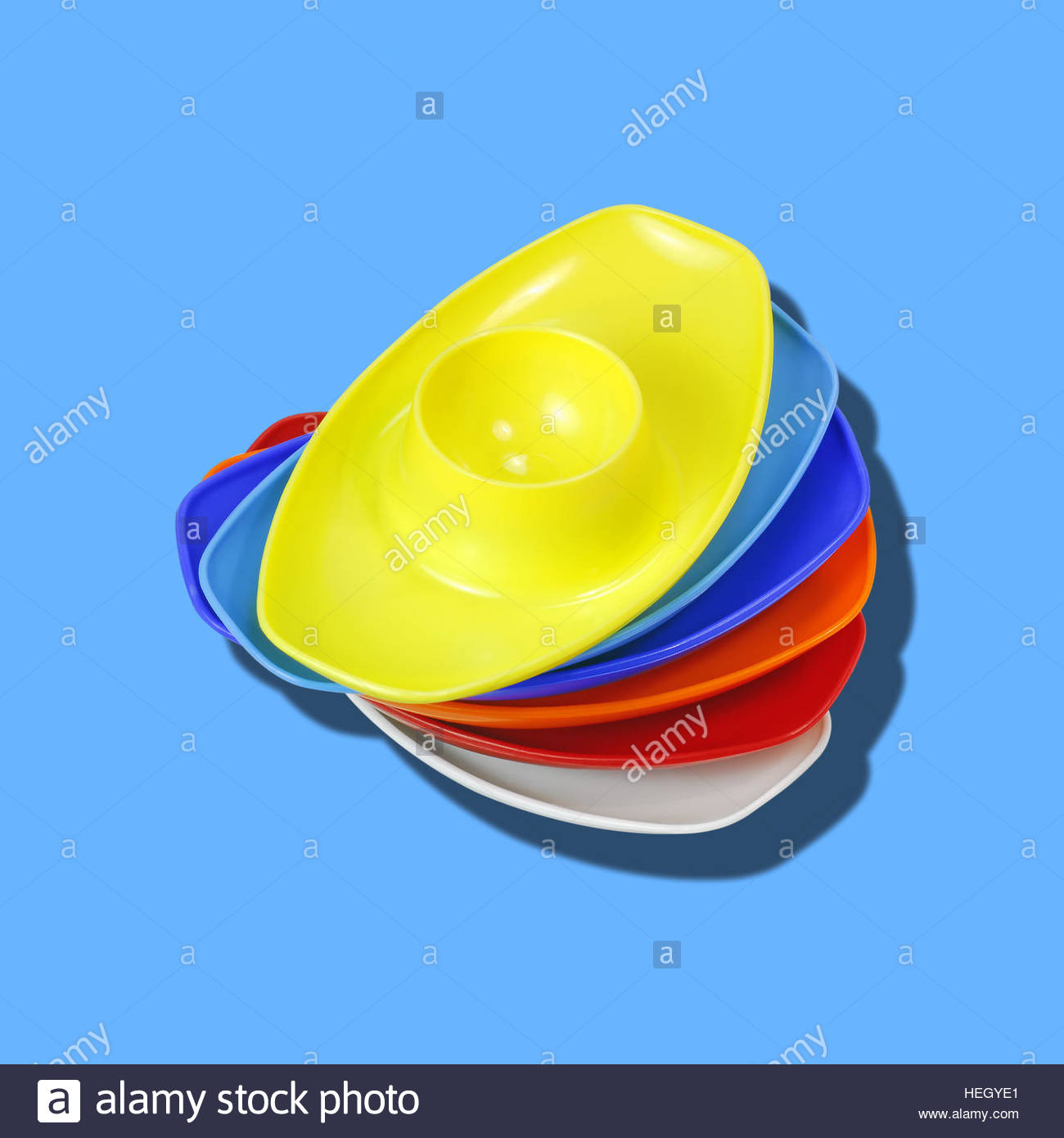 Egg Cups Plastic Vintage food holder kitsch retro isolated mid century on plain background - Stock Image
