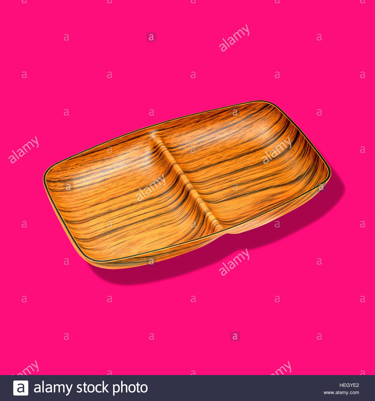 Wood effect formed dish tray plastic vintage food holder kitsch retro isolated mid century food on plain background - Stock Image