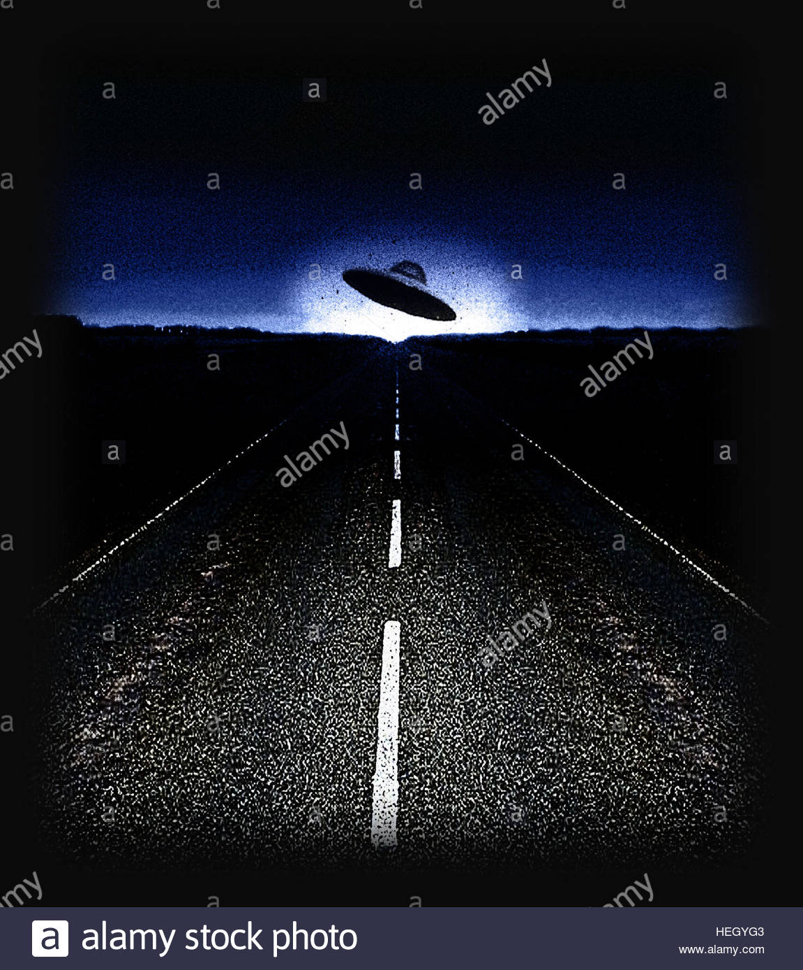 UFO on road at night retro space age gray flying saucer close encounter - Stock Image