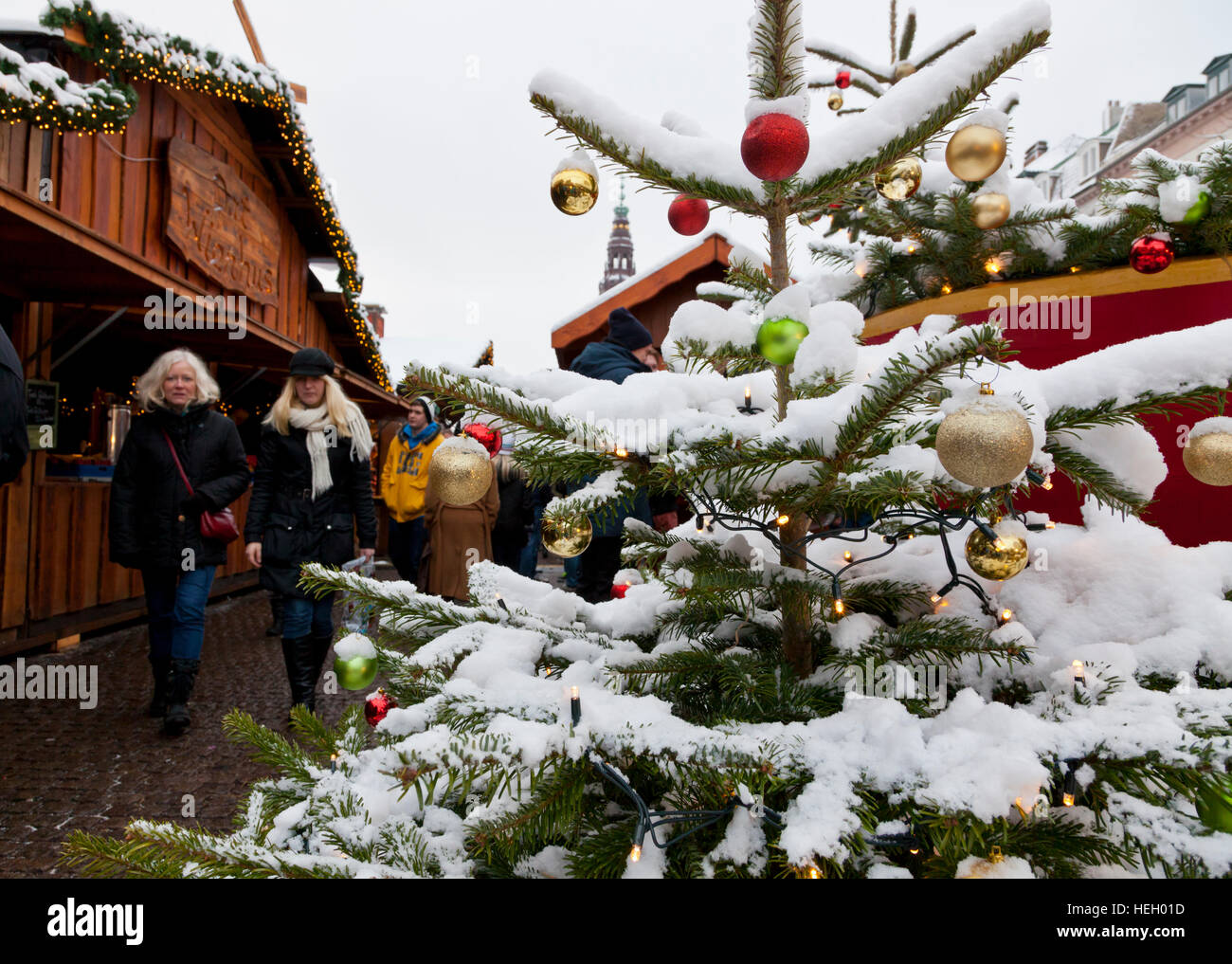 Decorated Christmas tree with snow at Christmas market on Højbro Plads, Hoejbro Square, on Strøget, Stroeget, - Stock Image