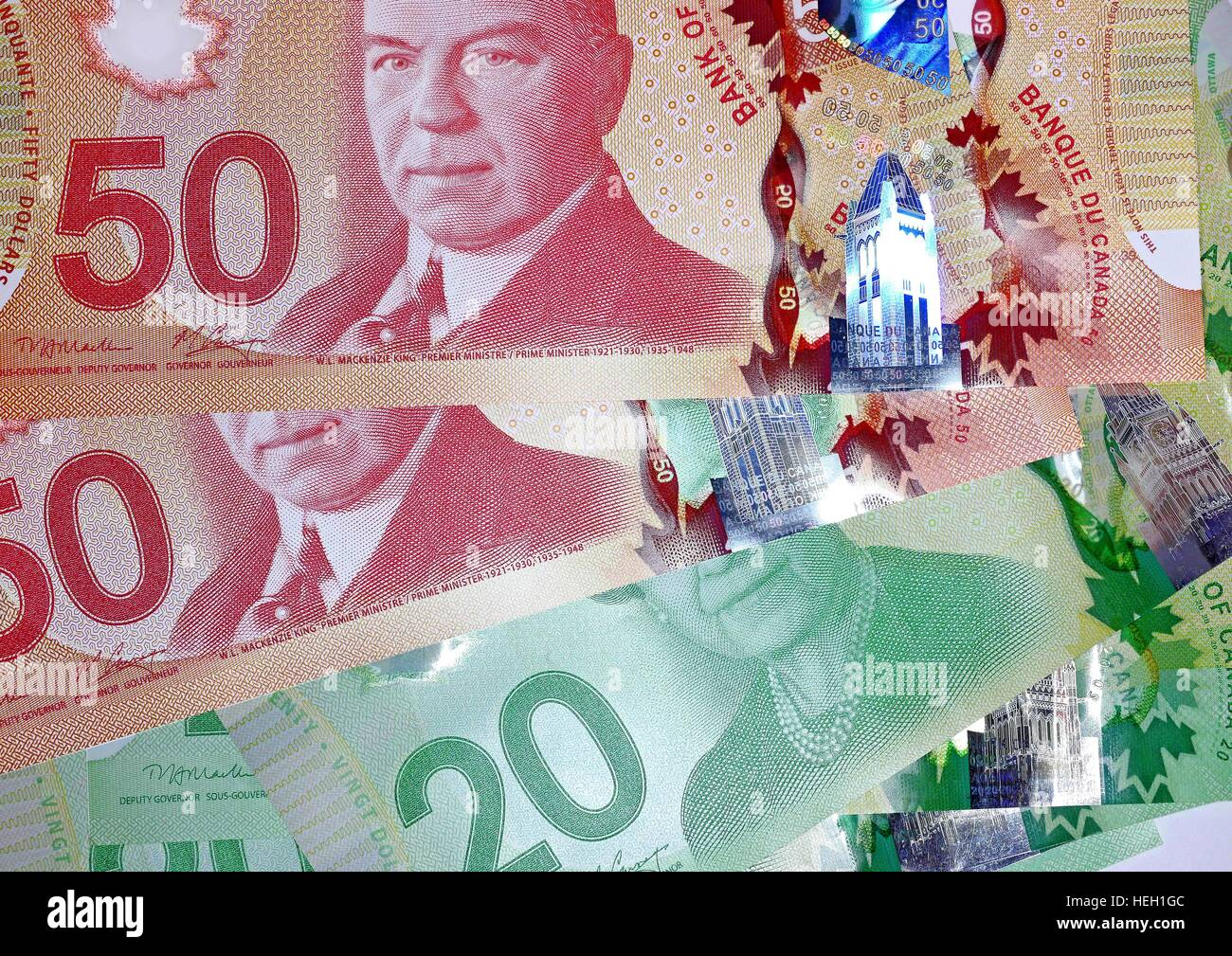 The Bank of Canada issued new high tech polymer money with holograms that will last longer and be harder to counterfeit. - Stock Image