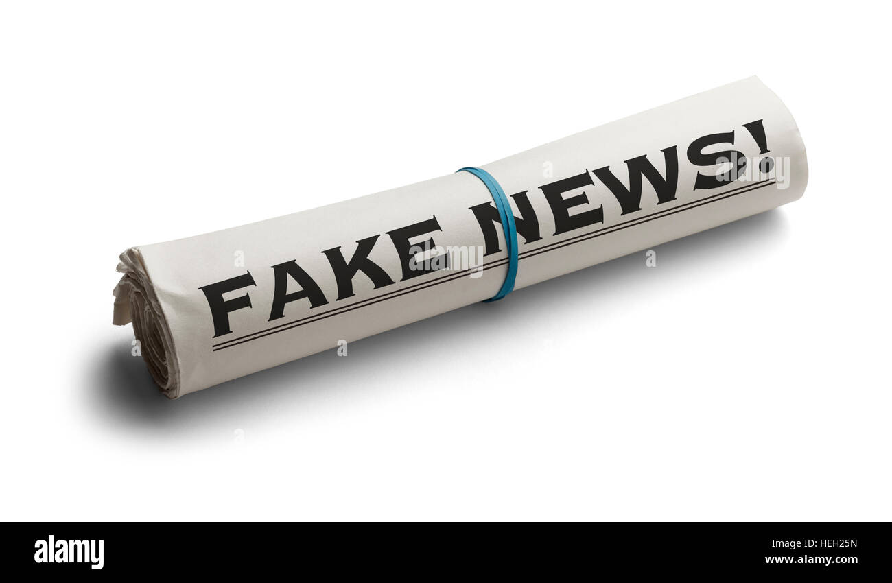 Rolled Up Newspaper with Headline of Fake News Isolated on White Background. - Stock Image
