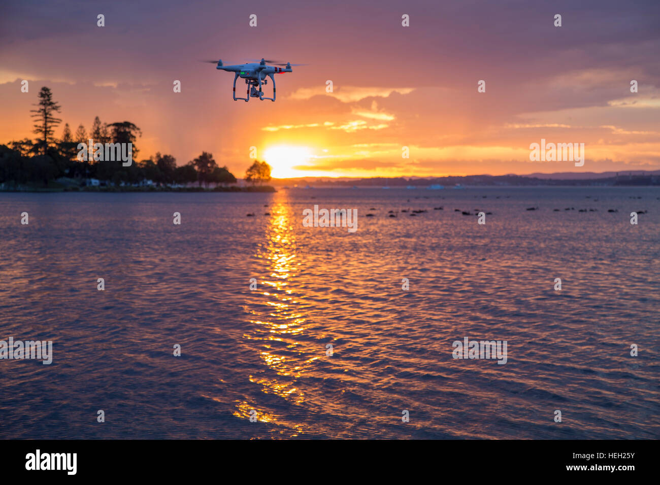 Drone flying at Sunset - Stock Image