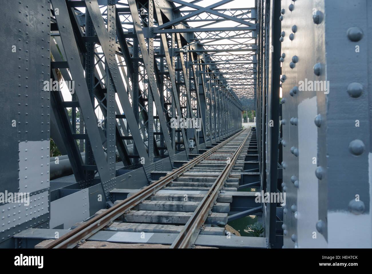 Iron bridge and train line - Stock Image