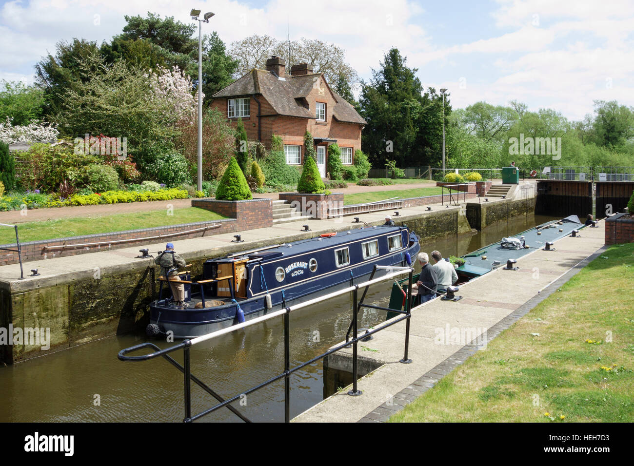 A narrow boat passing through Hambleden lock on the river Thames, Berkshire, England - Stock Image