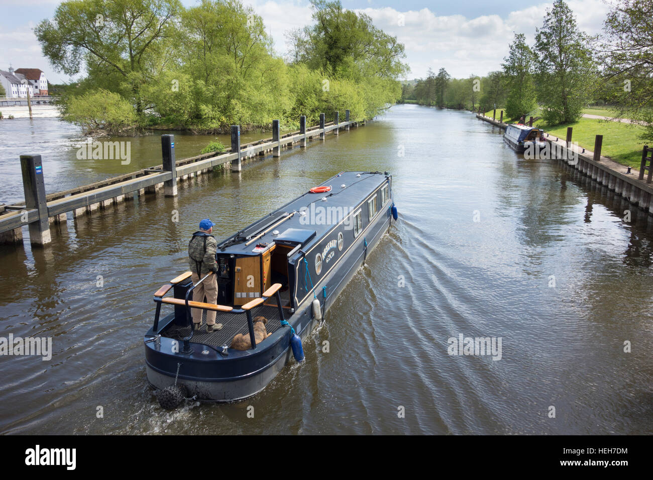 A narrow boat cruising on the river Thames at Hambleden lock, Berkshire, England - Stock Image