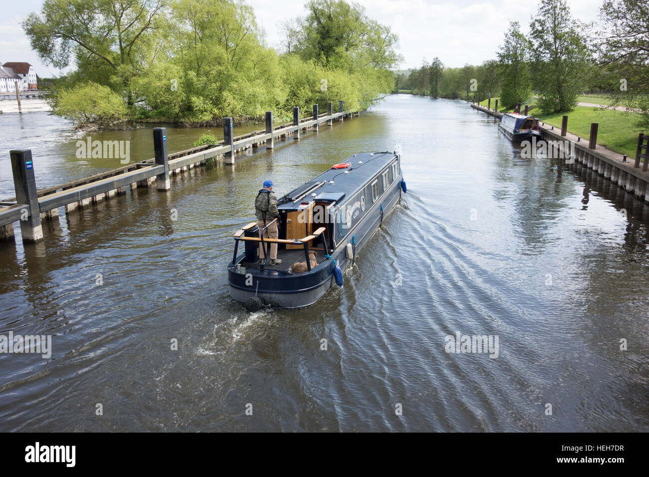 A narrow boat cruising on the river Thames at Hambleden lock, Berkshire, England, UK - Stock Image