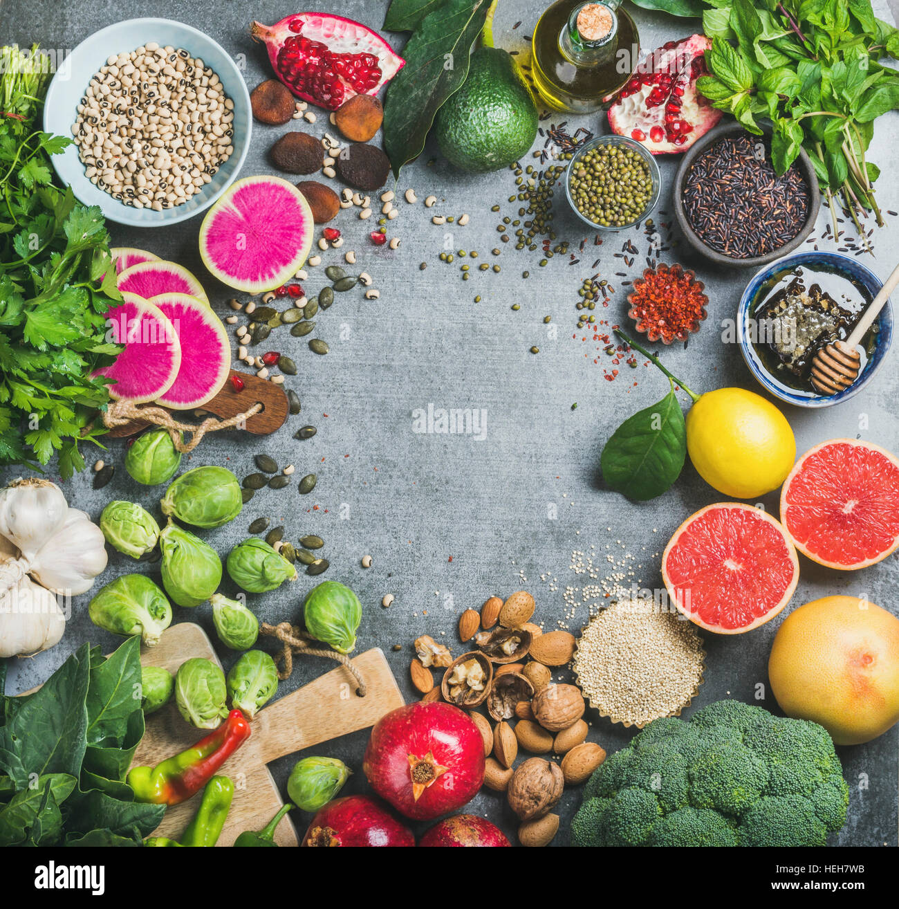 Clean eating concept. Variety of vegetables, fruit, seeds, cereals, beans, spices, superfoods, herbs, condiment Stock Photo