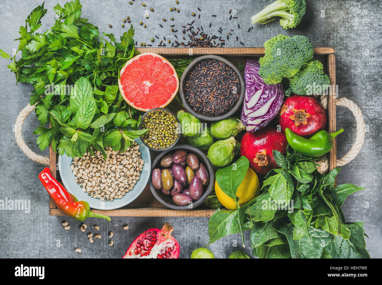 Fresh vegetables and fruits, seeds, cereals, beans, spices, superfoods, herbs, condiment in wooden box for vegan, - Stock Image