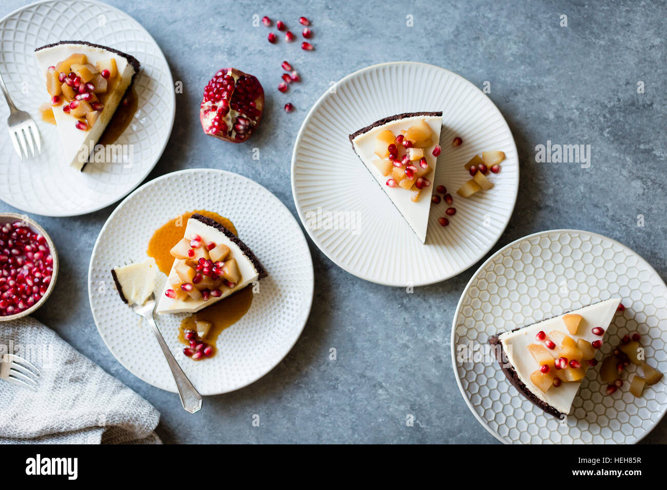 Chocolate Crusted Chèvre Cheesecake with Earl Grey Poached Pears & Pomegranate (gluten-free) - Stock Image