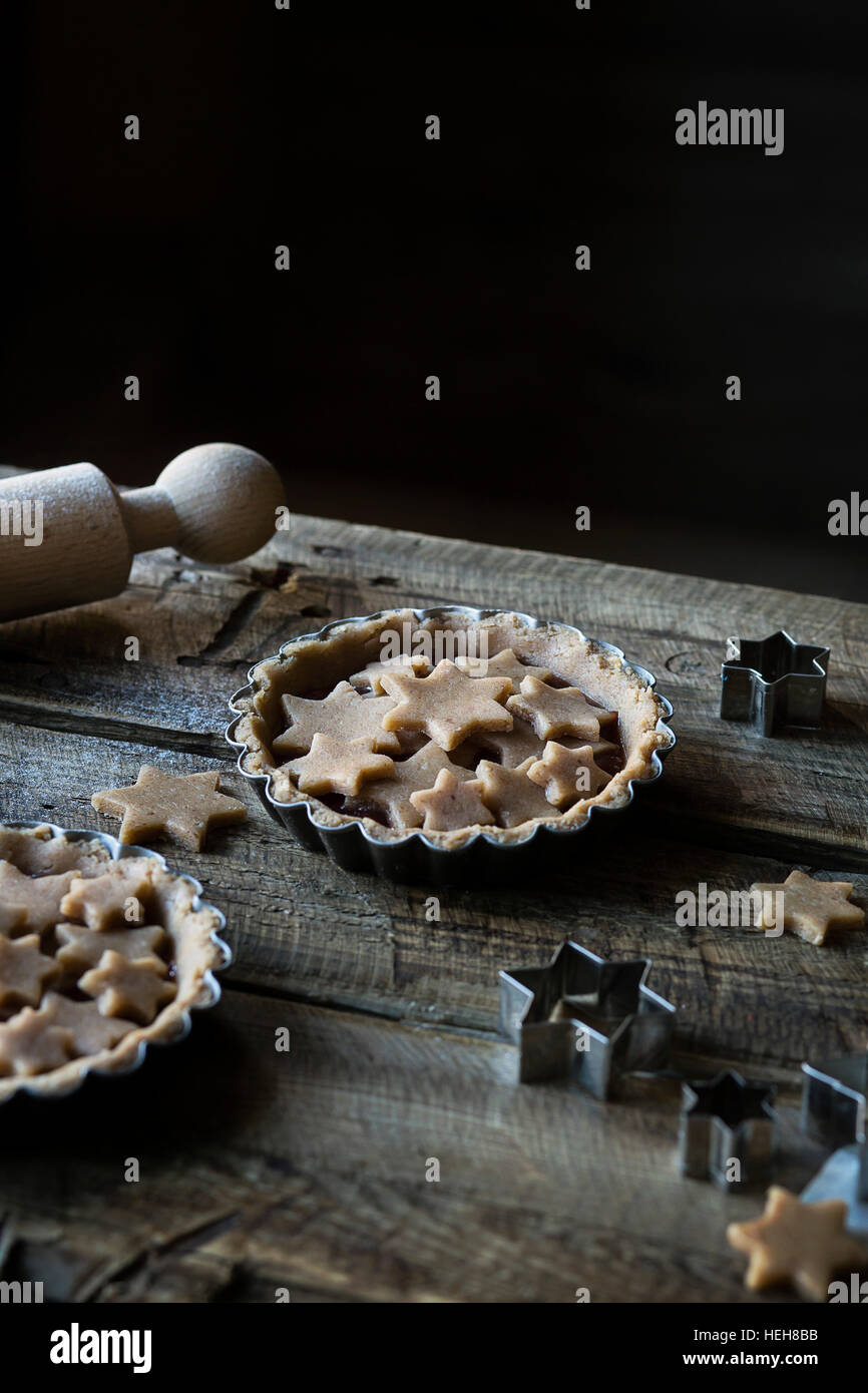 Tarts with stars decoration on wooden table - Stock Image