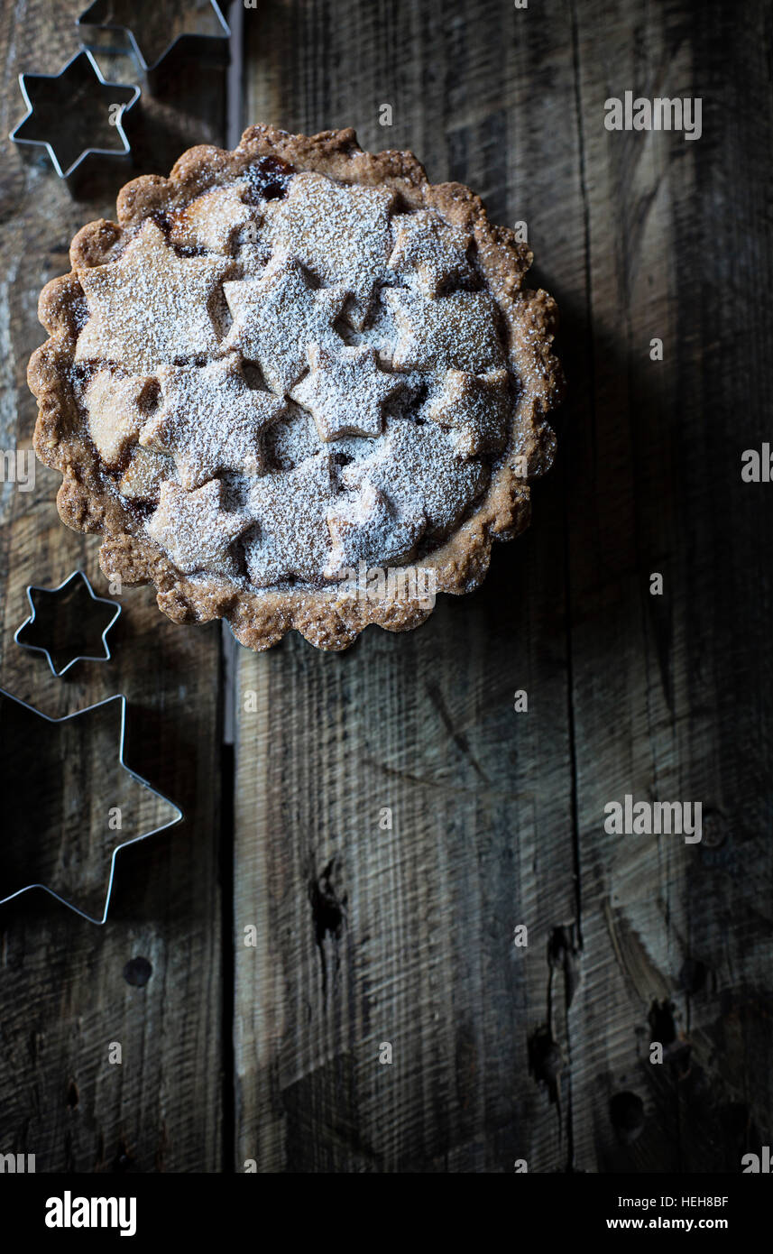 Tart with stars decoration on wooden table - Stock Image