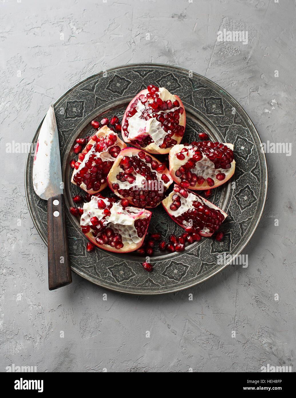 Juicy pomegranates on wood - Stock Image