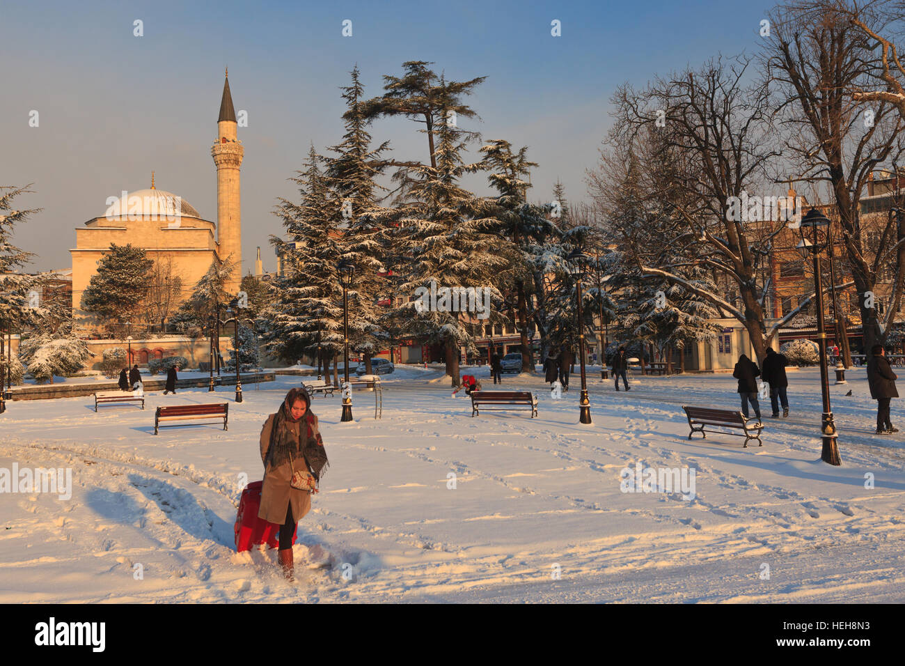 After of a heavy snow fall in Istanbul , People of Istanbul are in a hurry to go to the work while the tourists - Stock Image