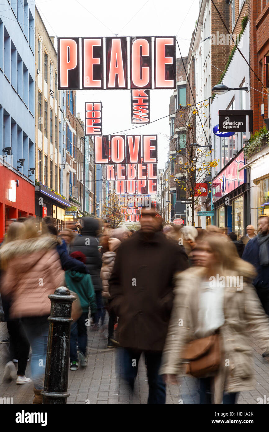 Many Christmas shoppers in motion blur on Carnaby Street, London. In London, England. - Stock Image