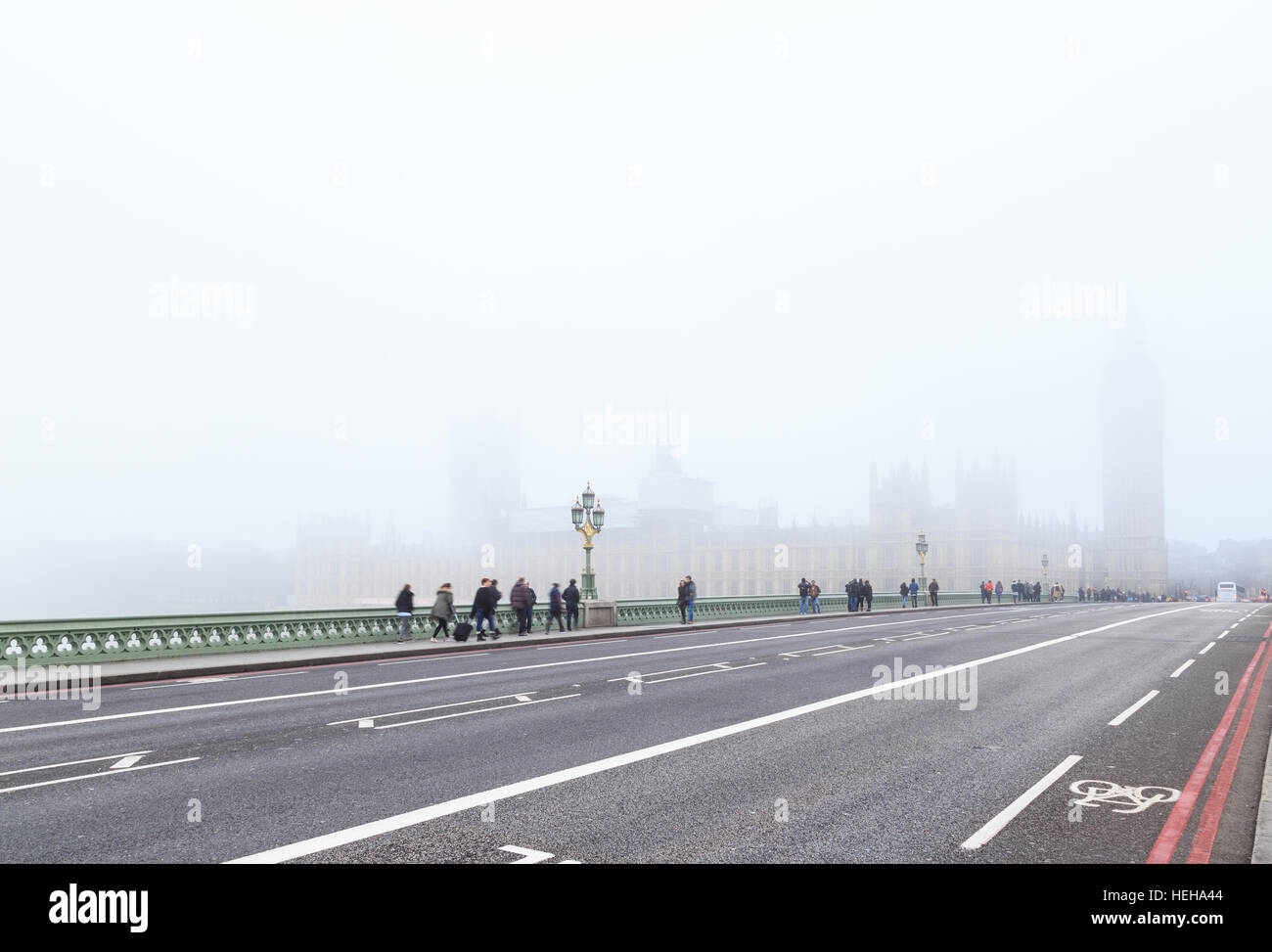 Tourists on Westminster Bridge, London. In London, England. On 17th December 2016. Stock Photo