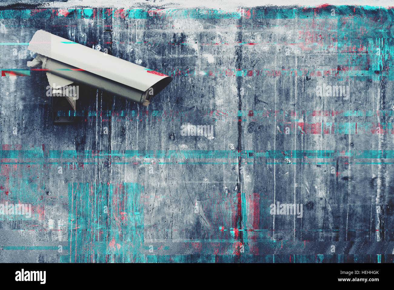 CCTV security and surveillance camera with digital glitch effect - Stock Image