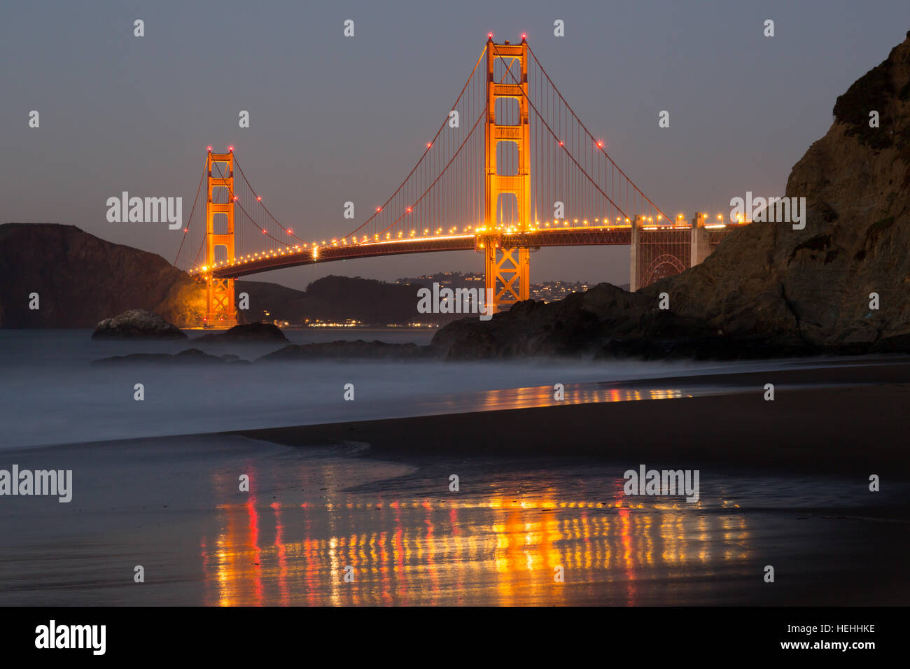 The Golden Gate Bridge and Baker Beach Reflections - Stock Image