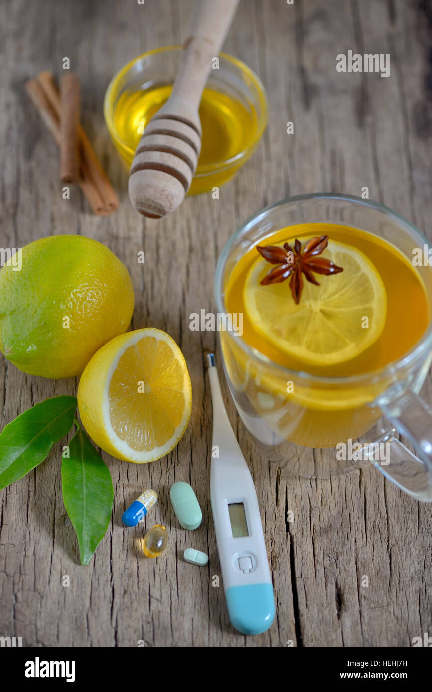 Traditional medicine and flu concept - cup of tea with lemon and honey - Stock Image