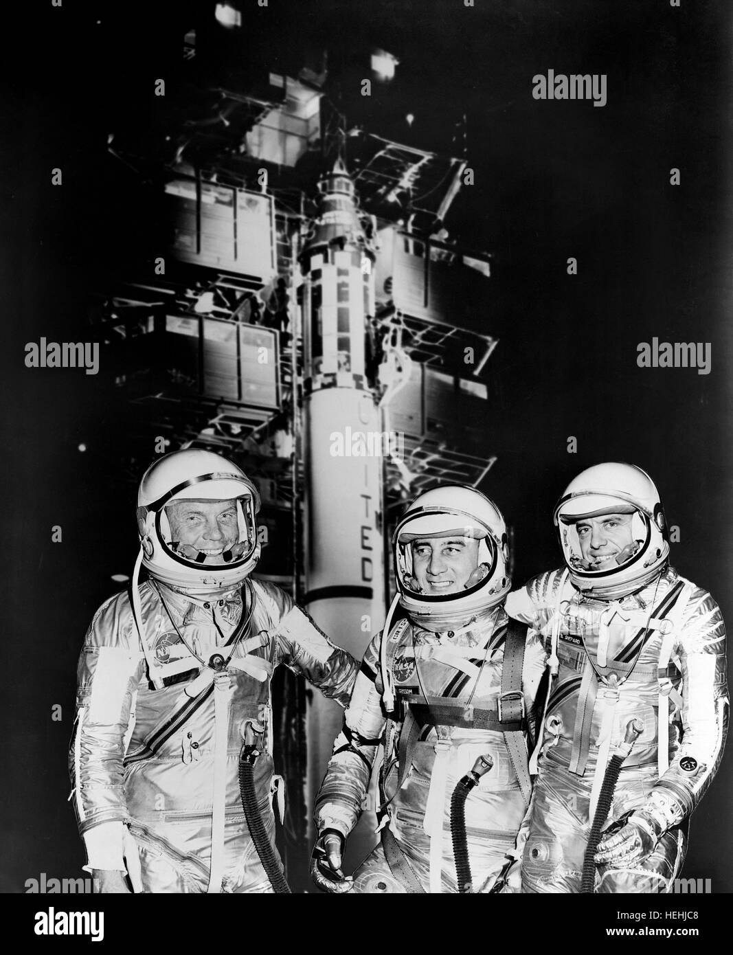 NASA Mercury astronauts (L-R) John Glenn, Gus Grissom, and Alan Shepard stand next to the Redstone rocket in their - Stock Image