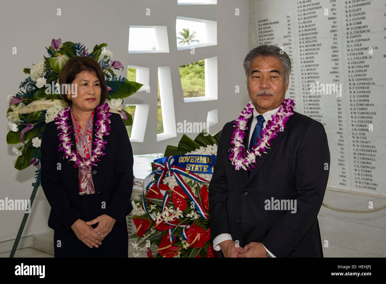 Hawaiian Governor David Ige and his wife Dawn Ige honor fallen U.S. World War II soldiers from the Pearl Harbor - Stock Image