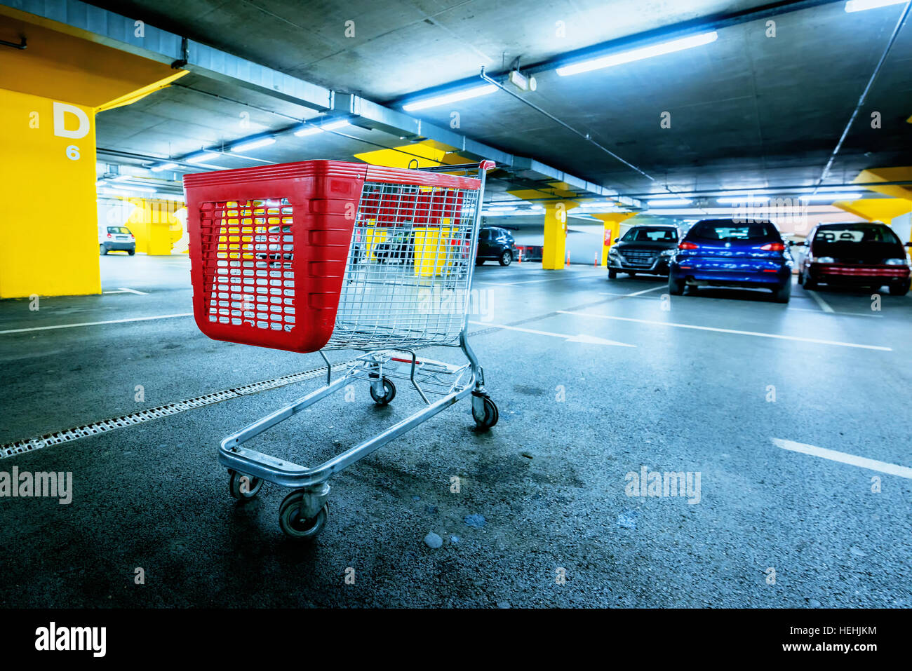 Abandoned empty cart in shopping mall underground garage parking lot, retail and consumerism concept - Stock Image