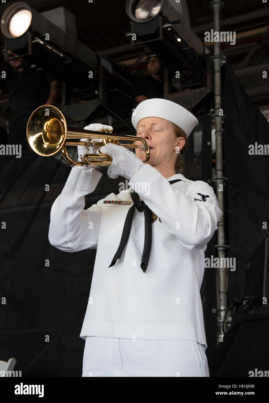 A U.S. Pacific Fleet Band member performs Taps on a bugle during the 75th Commemoration Event of the attacks on - Stock Image