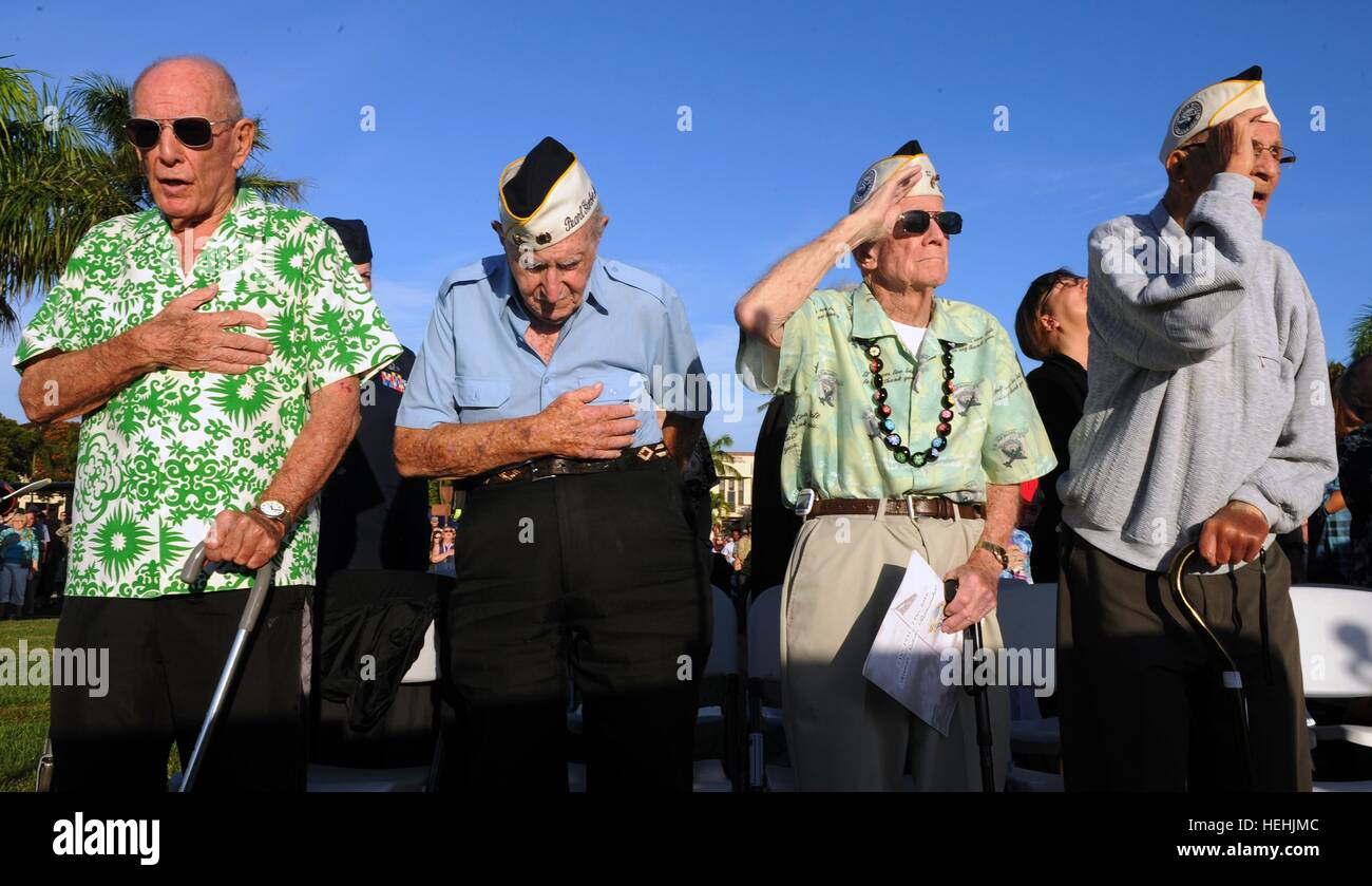 U.S. World War II veterans and Pearl Harbor attack survivors stand during the National Anthem at the 75th Anniversary - Stock Image