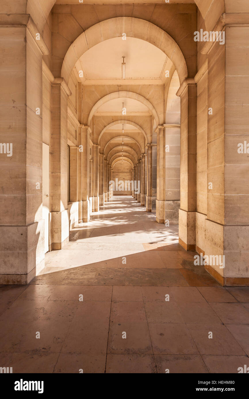 Looking down the arcaded street in rue Dupanloup, Orleans. - Stock Image
