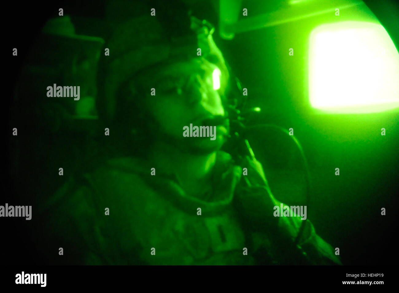 U.S. Army 1st Lt. Kenneth Jura of 1st Battalion, 27th Infantry Regiment, 25th Infantry Division, monitors radio Stock Photo