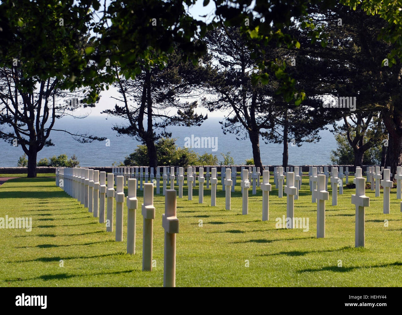 Rows Of White Crosses In The Normandy American Cemetery And Memorial Mark Graves