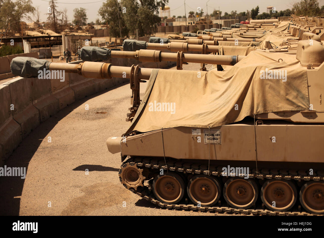 A line of M109A6 Paladins, assigned to Alpha Battery, 3rd Battalion, 82nd Field Artillery Regiment, 2nd Brigade - Stock Image