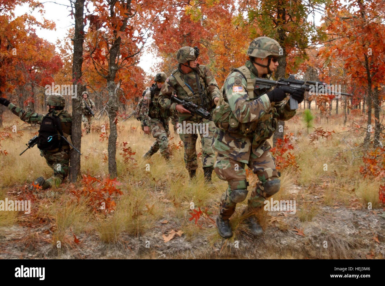 011205-A-5406-001 Paratroopers pull security as they cross a linear danger area on their way to assault an objective - Stock Image
