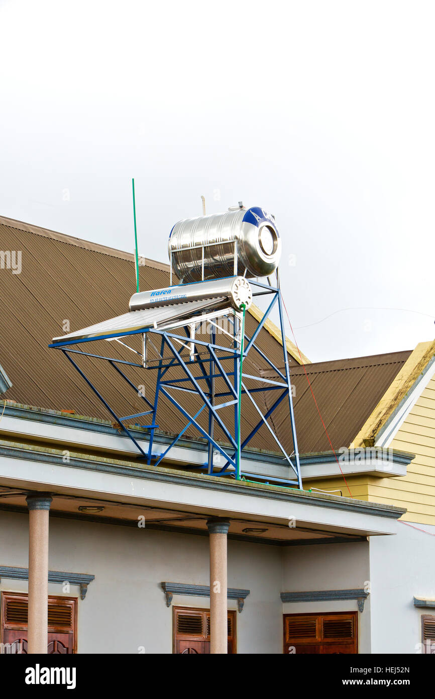 Solar hot water heater with tank installed on rooftop,  private residence, Vietnam, Asia. - Stock Image