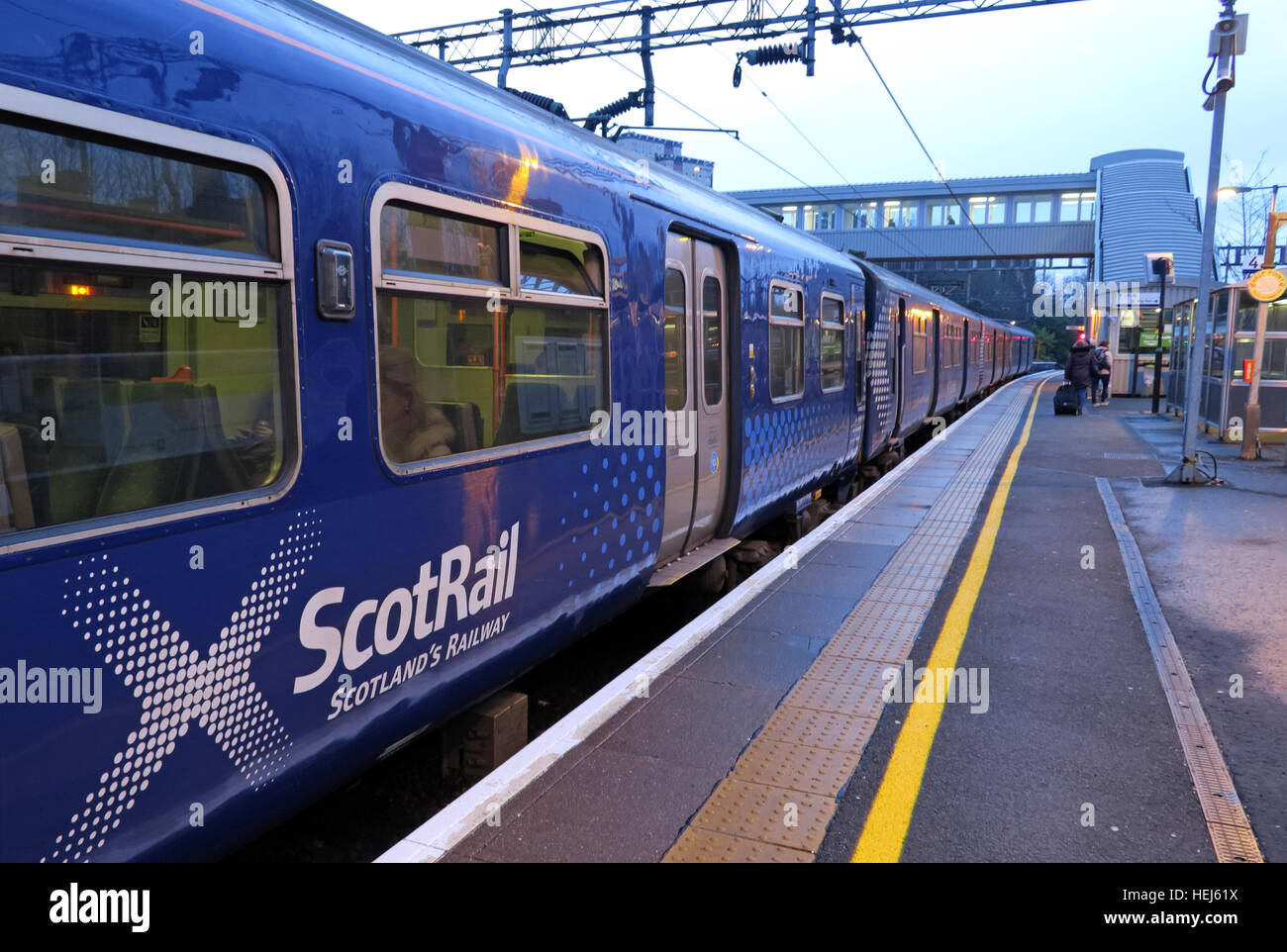 Scotrail Abellio train carriages in Motherwell station at dusk. - Stock Image