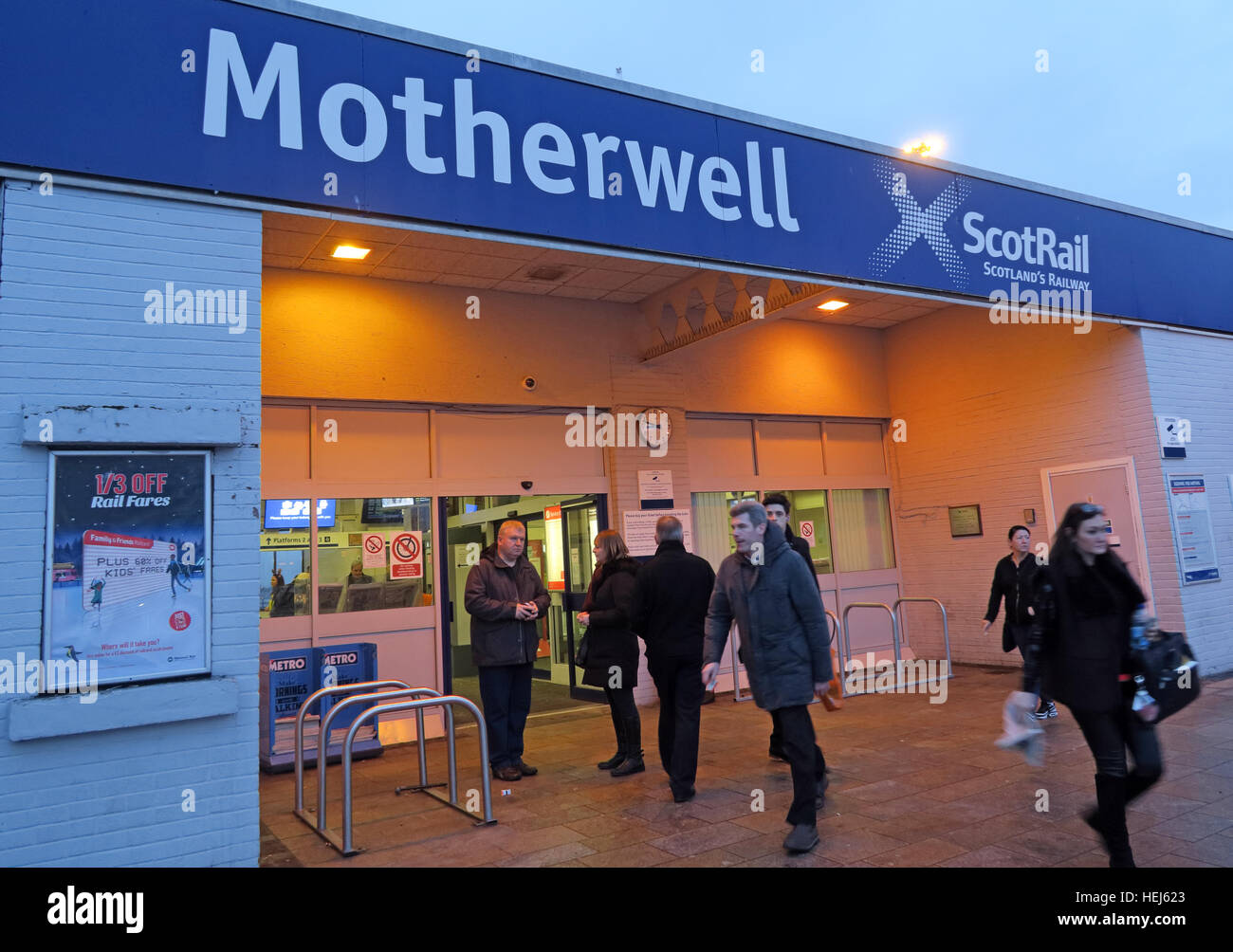 ScotRail railway station Motherwell,North Lanarkshire,Scotland,UK at dusk - Stock Image