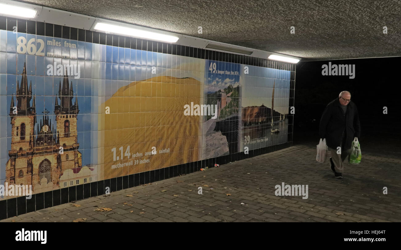 Motherwell Town Centre Underpass at night,Lanarkshire,Scotland,UK with shopper Stock Photo
