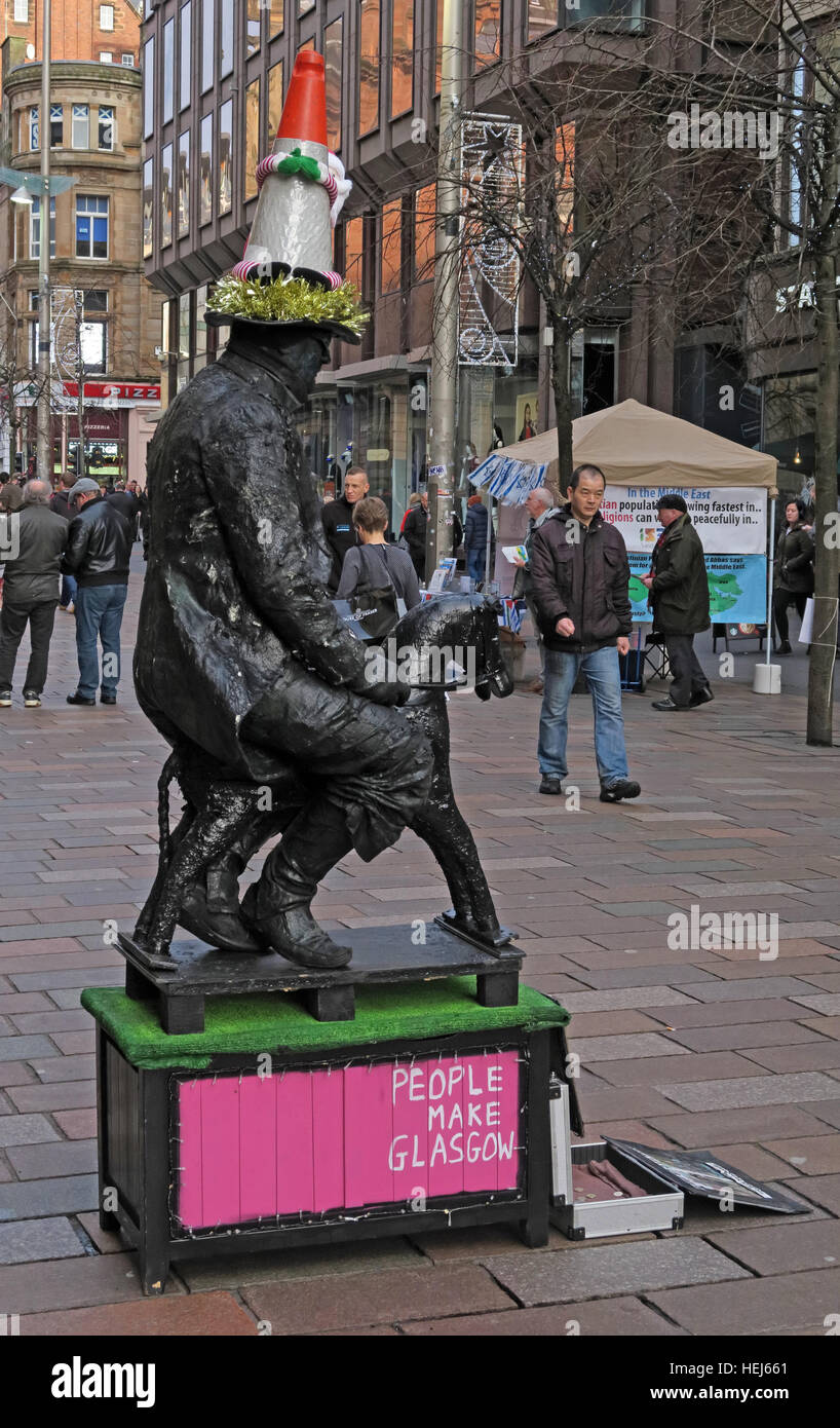 People Make Glasgow busker,Buchanan Street,entertainer, Strathclyde, Glasgow, Scotland - with traffic cone - Stock Image