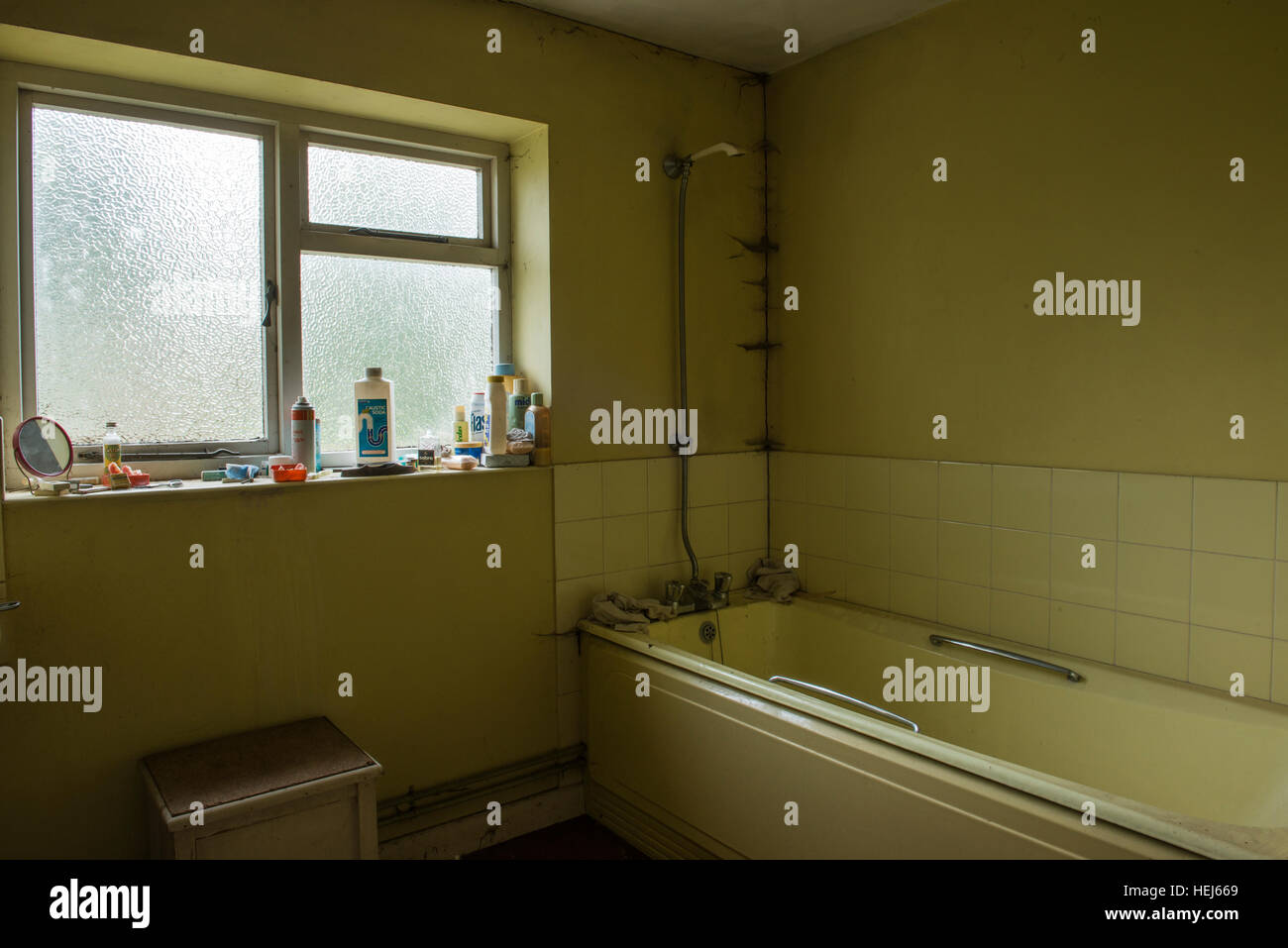 The bathroom inside an abandoned and derelict house with a small ...