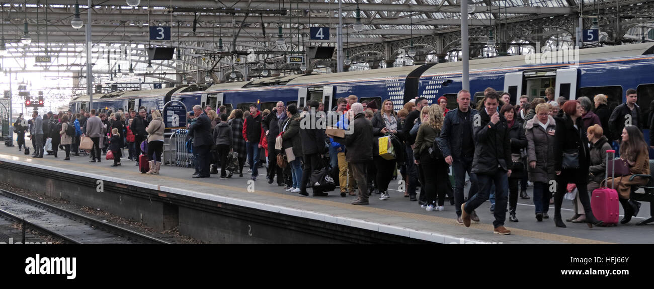 Very Busy Scotrail Abellio train carriages. Franchise threat to bring back into state ownership,after poor service - Stock Image