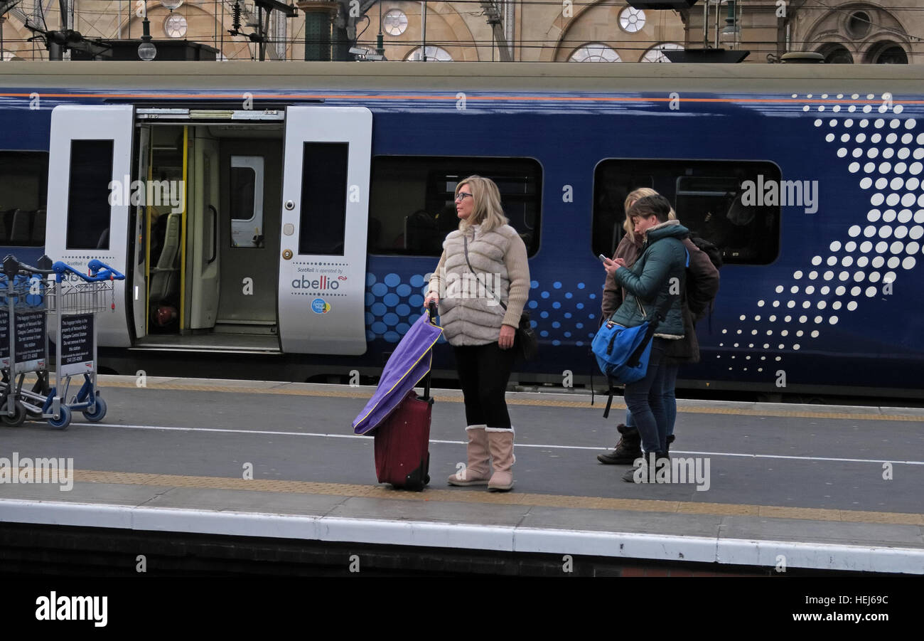 Scotrail Abellio train carriages & passengers,petition to bring back into state ownership,after poor service - Stock Image