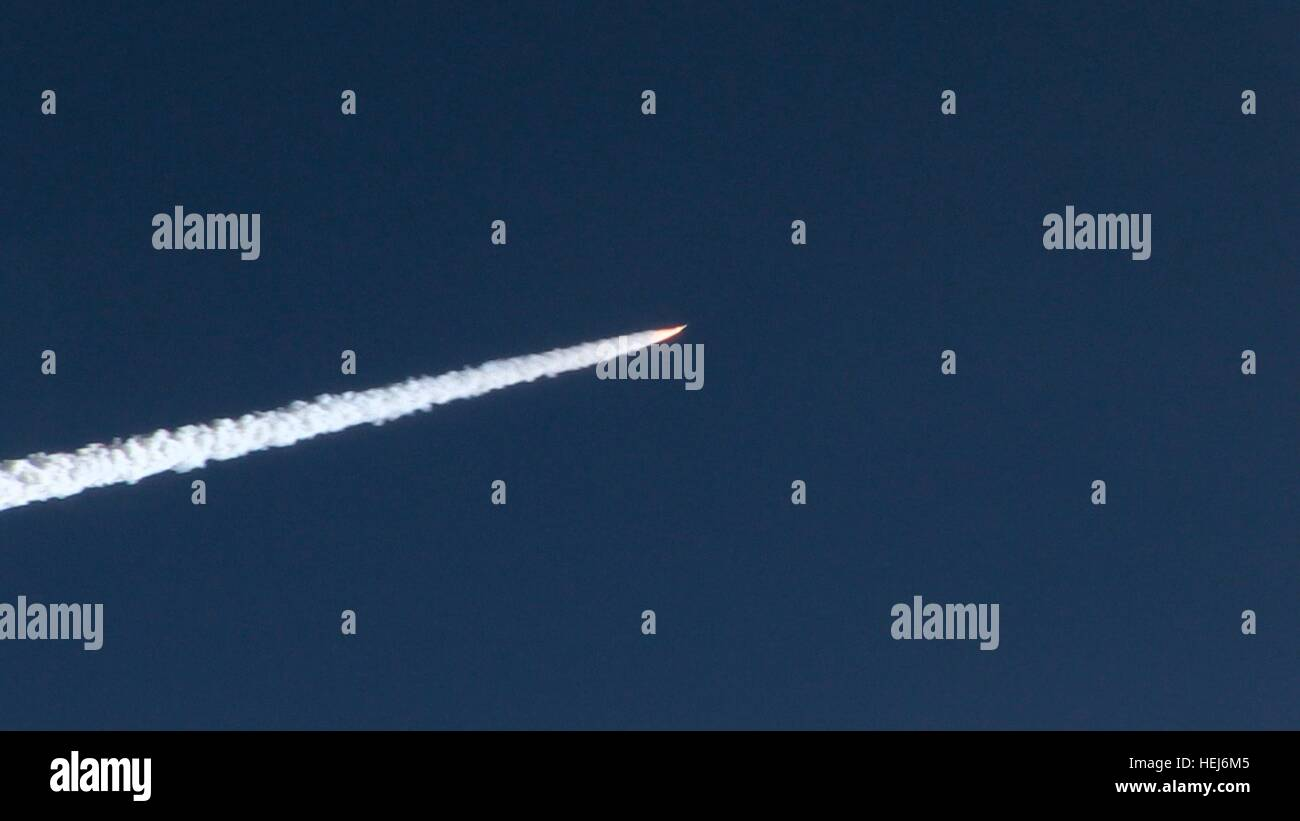 The Orbital ATK Pegasus XL rocket and NASA CYGNSS spacecraft launches over the Atlantic Ocean after being carried - Stock Image