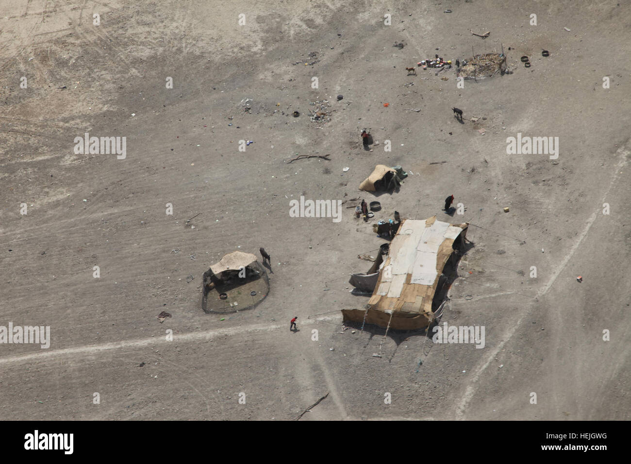 A Bedouin encampment sits in the midst of the desert during a flyover of Dhi Qar province in southern Iraq, Sept. - Stock Image