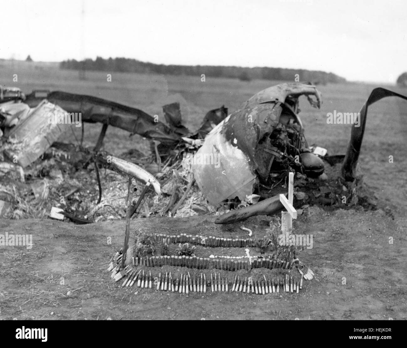 The grave for the pilot was made by a refugee French couple, with .50-cal. ammunition for a border. - Stock Image