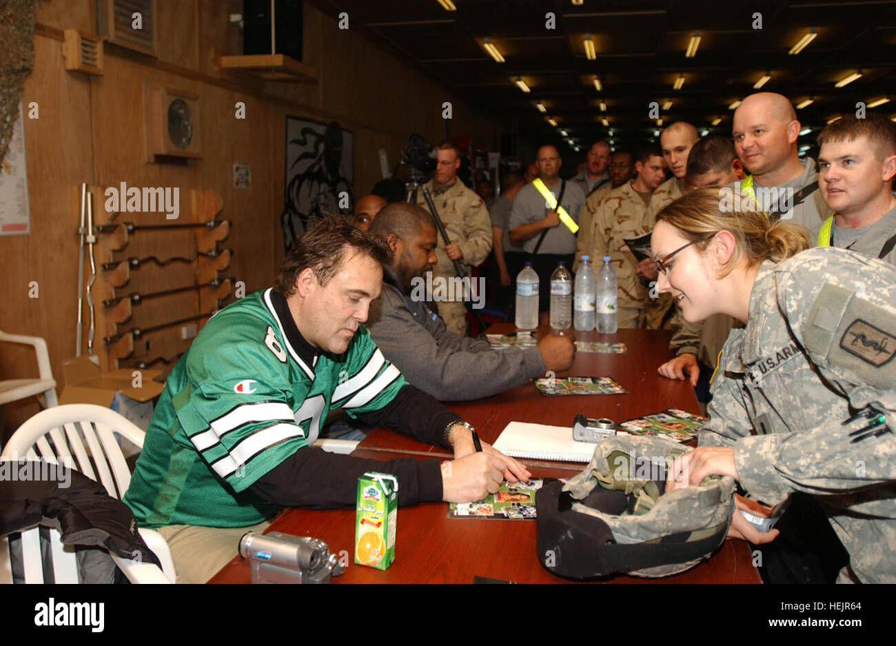 Kansas City Chief's all time point leader Nick Lowery sings and autograph for 1st Lt. Kelly Baumgartner, an officer - Stock Image