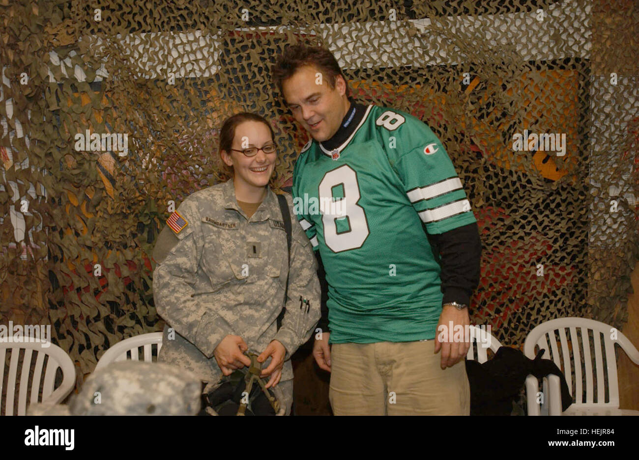 Kansas City Chief's all time point leader Nick Lowery poses with 1st Lt. Kelly Baumgartner, an officer with the - Stock Image