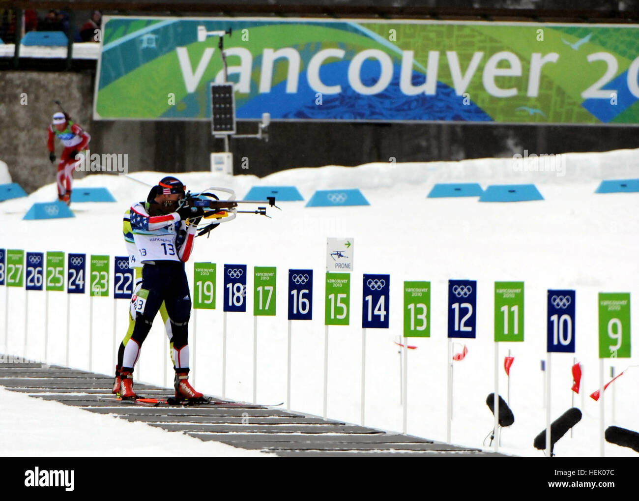 U.S. Army World Class Athlete Program biathlete Sgt. Jeremy Teela shoots to a ninth-place finish in the Olympic Stock Photo
