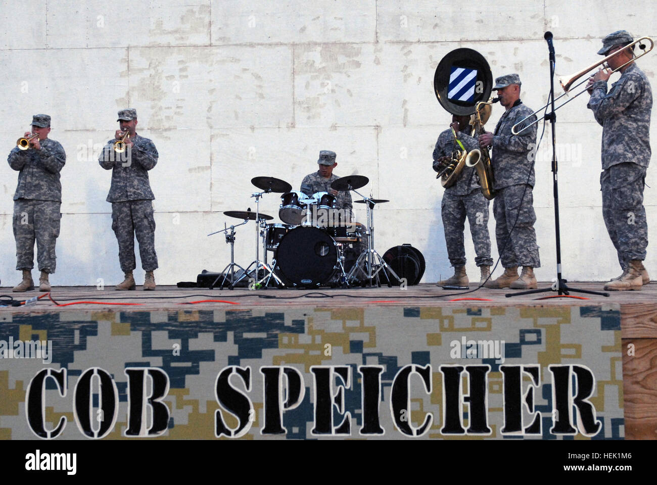 Spc. Calvin Scarborough, a tuba player with the 3rd Infantry Division Band, brings on the funk with five other band - Stock Image