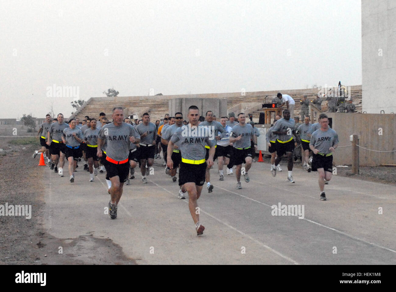 Runners start off the race with furious ambition followed by the walkers of the Division Special Troops Battalion - Stock Image