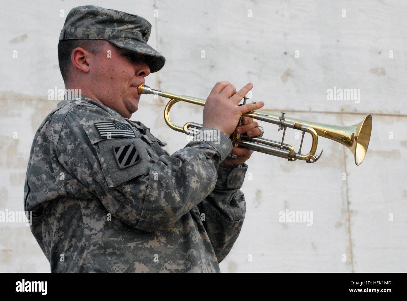 Sgt. Justin T. Miller, a trumpet player with the 3rd Infantry Division Band, Division Special Troops Battalion, - Stock Image